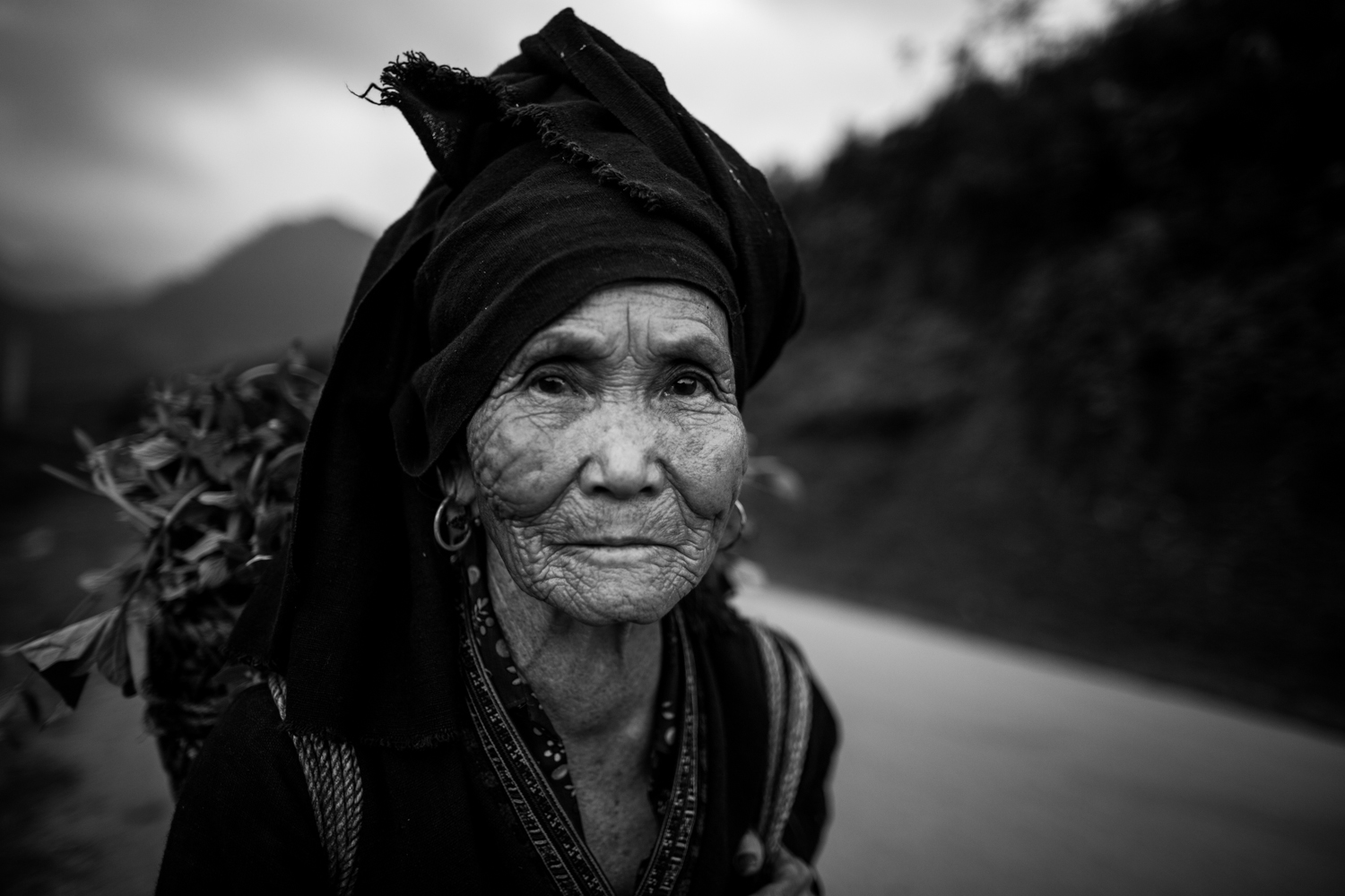 Old Hmong lady on the road