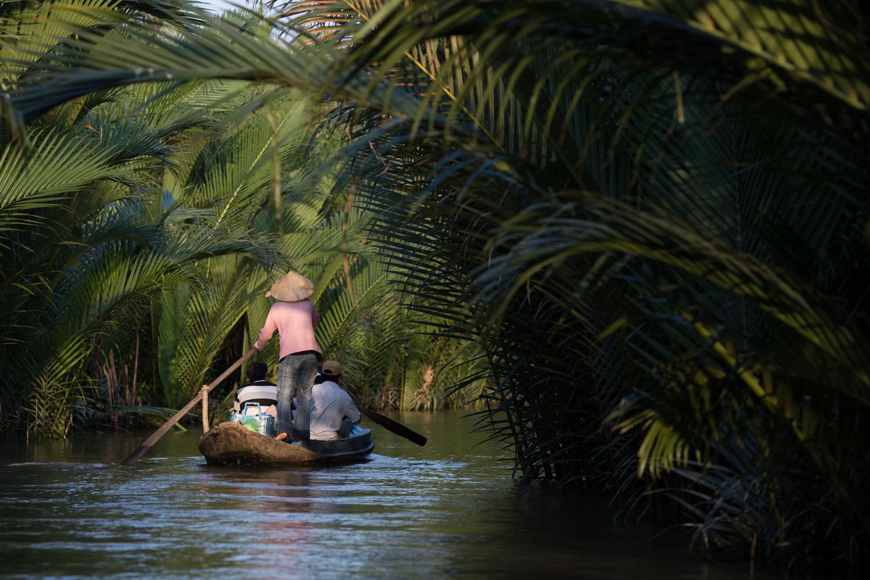 Woman rowing in an arroyo
