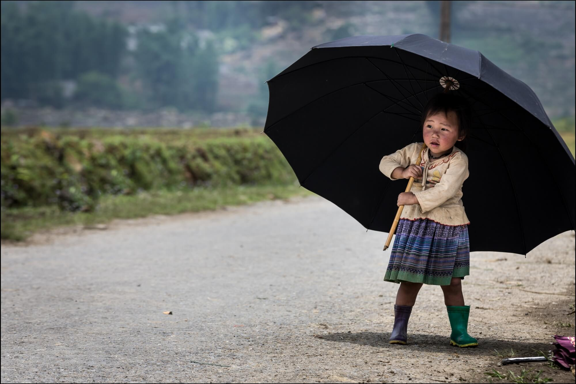 Vietnam Minority Child with black Umbrella