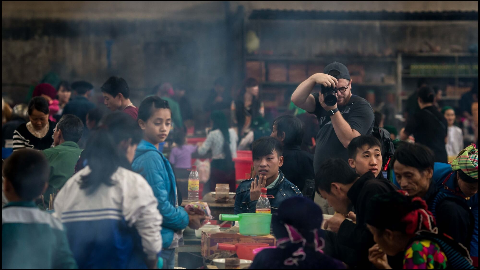 Photographer capturing busy restaurant activity in North Vietnam mountainous region