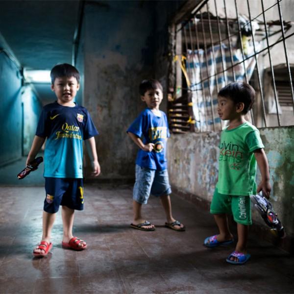 Kids in bluish corridor
