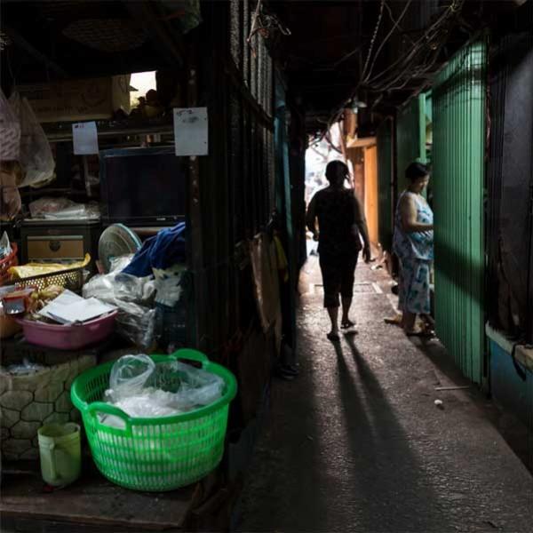 Drop shadow in a market alleyway